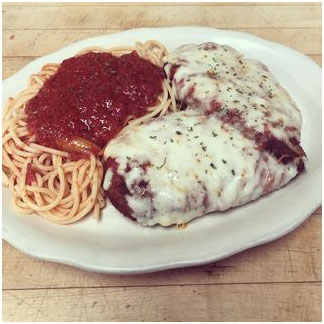 Chicken parmesan with a side of spaghetti